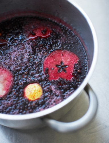 Stewed elderberries in a pot