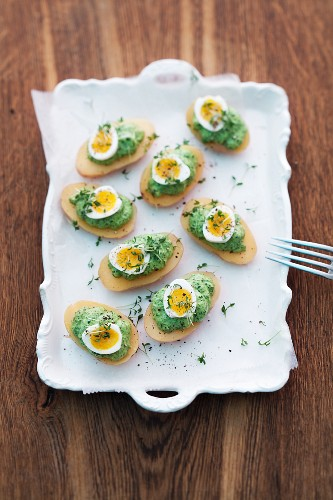 Green sauce with quail eggs and potatoes