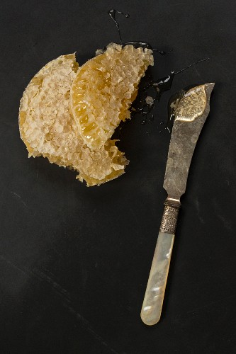 A honeycomb and a knife