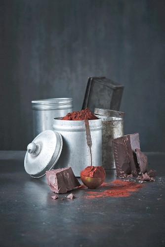 Tins filled with various chocolate ingredients (cocoa, chocolate blocks)