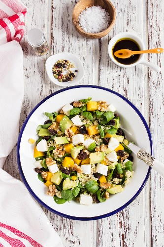 Quinoa salad with avocado, mango and lambs lettuce