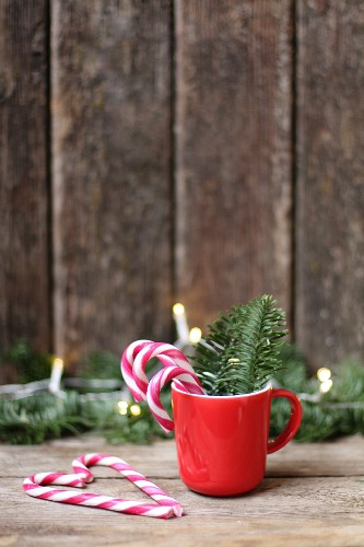 Candy canes in red Christmas mug