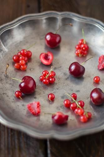 Berries and cherries in a metal bowl
