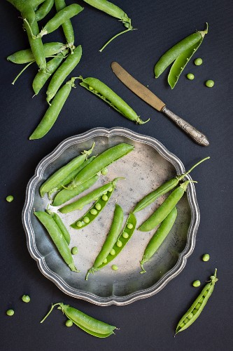 Green pea pods, partly open
