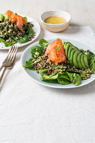 Smoked salmon, spinach and avocado quinoa salad with fresh mind and toasted seeds