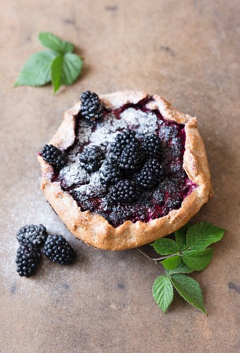 Blackberry galette with icing sugar