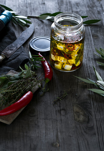Preserved feta cheese in olive oil with chilli peppers and herbs