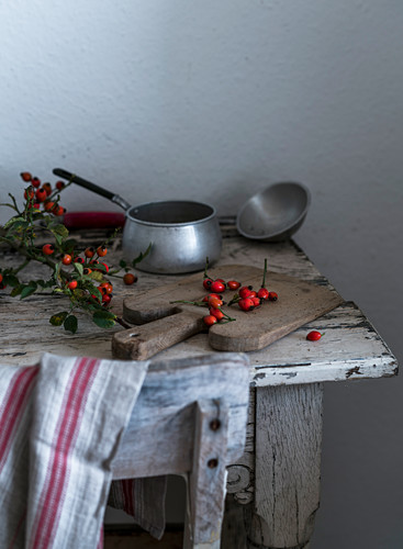 Rosehips on a wooden table