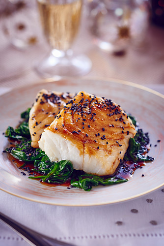 Cod with sesame seeds on a bed of spinach