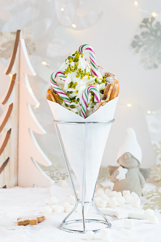 A bubble waffle with frozen yoghurt and pistachios for Christmas