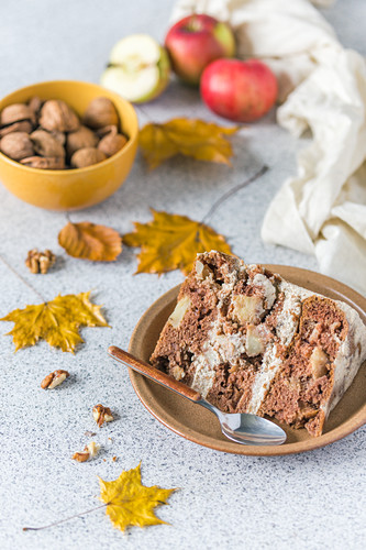Slice of a apple layer cake with walnut frosting