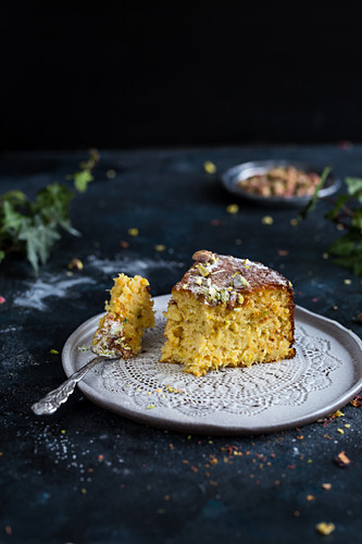 A slice of orange rose and pistachio cake