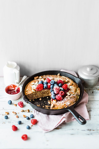 Chocolate cheesecake with berries in a pan