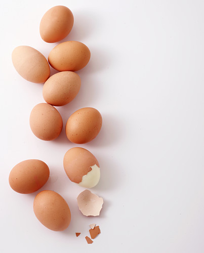 Boiled brown eggs on white background