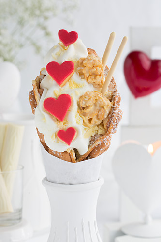 A bubble waffle with frozen yoghurt, heart-shaped biscuits, crispy chocolates and chocolate