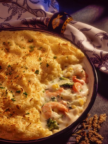 Creamy prawn bake with sweetcorn, carrots, broccoli and a potato topping