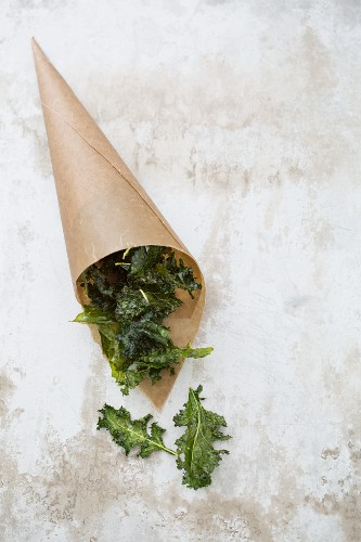 Kale crisps in a brown paper bag