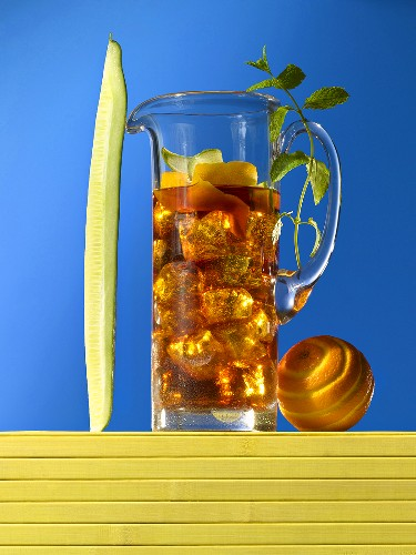 A jug of Pimms with ice cubes