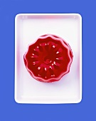 Turned-out raspberry jelly on rectangular dish