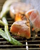 Tuna steak on the barbecue, a piece cut off