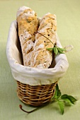 Herb baguettes in a bread basket