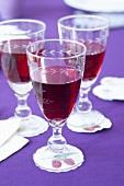 Three glasses of blackberry juice