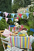 Table laid for children's party out of doors
