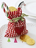 Assorted Christmas sweets in checked bag