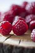 Raspberries on a wooden surface (close-up)