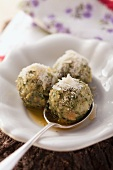 Spinach dumplings with Parmesan and melted butter