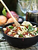 Cauliflower salad with bacon, chard and roasted almonds