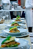 Salmon dishes in a commercial kitchen