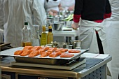 Prepared salmon fillets in a commercial kitchen