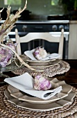 A place setting decorated with a garlic clove on a table in a country house kitchen (Provance, France)