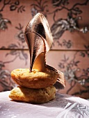 A high heeled shoe on a loaf of bread