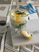 Egg in a glass with cream on spinach - hangover breakfast