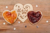 Hearts cut out of bread, topped with jam, for Valentine's Day
