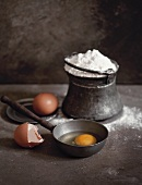 Eggs and flour in a rustic setting