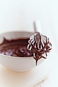Chocolate ganache on an egg whisk