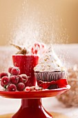 A Christmas cupcakes in an icing sugar snowstorm
