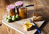 Greengage jam and bread on a chopping board