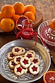 Jam biscuits with blood orange jelly