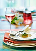 Place setting decorated with green tomato