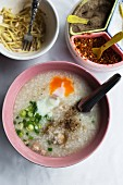 Khao tom (rice porridge with egg, Thailand)