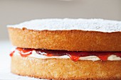 Victoria sponge cake with cream and strawberry jam