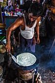 A cook making dosa (Yangon, Myanmar)
