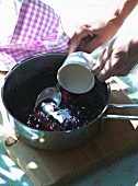 Blueberry jam being made