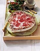 Heart-shaped yoghurt cherry cheesecake with grated chocolate