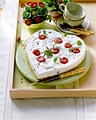 Heart-shaped yoghurt cherry cheesecake, with jelly cherries