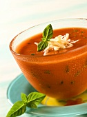 Quick tomato soup with cheese and basil